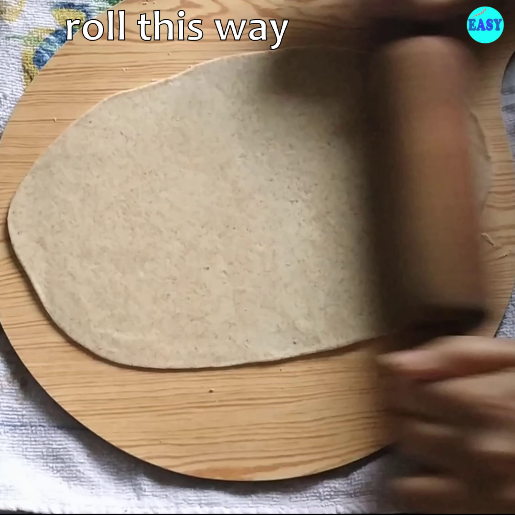 Step 4 - Roll it thin creating an elongated circle.